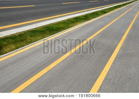 Detail of a road with yellow lines
