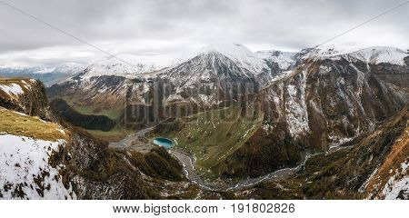 Caucasian Mountain in winter. Cross Pass in Georgia. Gudauri District. Source of Aragvi River. View from Soviet Monument to Russian Georgian Arch of Friendship of Peoples. Georgian Landmark