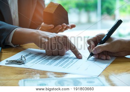 Home purchase agreement,Businessmen sign house purchase contract.