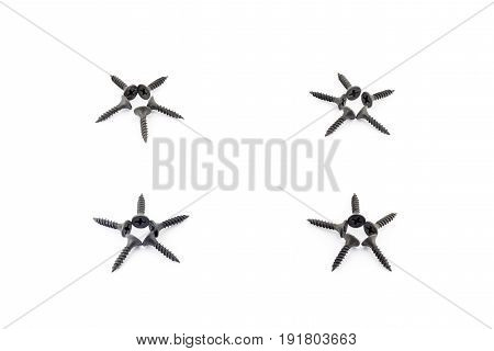 4 Stars Laid Out With Black Screws On White Background