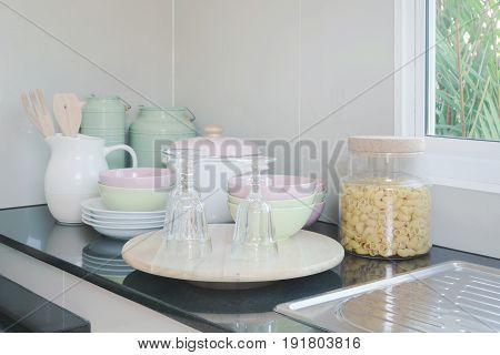 Ceramic Kitchenware On Black Granite Counter Top In The Kitchen