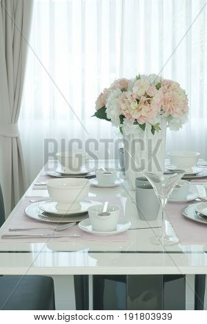 Pink Flower At The Center Of Romantic Dining Table In Dining Room