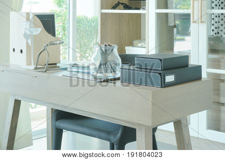 Modern Wooden Table With Pencil, Book And Magnifying Glass