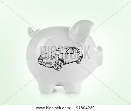 Piggy bank and drawings of car on color background. Concept of money and dream