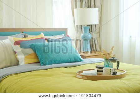 Tray Of Coffee Cups On Yellow And Green Bedding Decoration In Cozy Bedroom