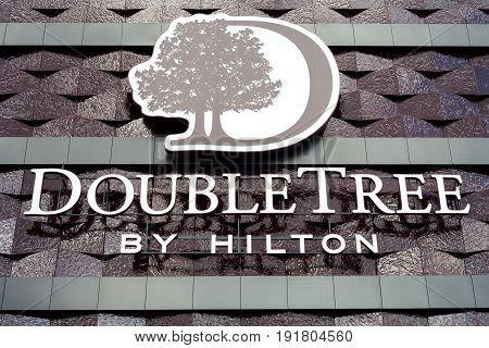 Minsk, Belarus - june 17, 2017: Logo on the facade of the hotel building Double Tree by Hilton Hotel Minsk