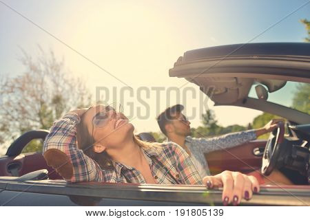 Couple of lovers driving on a convertible car - Newlywed pair on a romantic date.