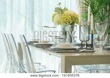 Dining Table With Vase Of Flower In Dining Room