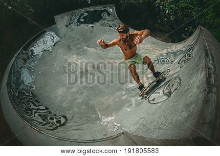 Skateboarder skateboarding at Ramp in outdoor skate park.