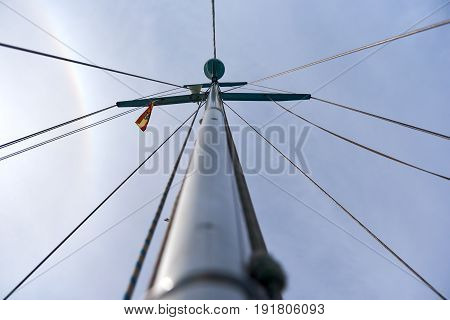 Mast of the sailing yacht against cloudy sky