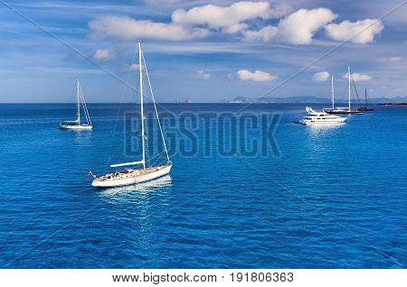 Early morning in Formentera. Sailboats at Cala Saona bay. Balearic Islands. Spain