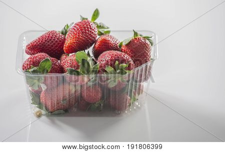 Fresh strawberry on gray background . Red strawberry. Loosely laid strawberries in different positions. Copyspace.