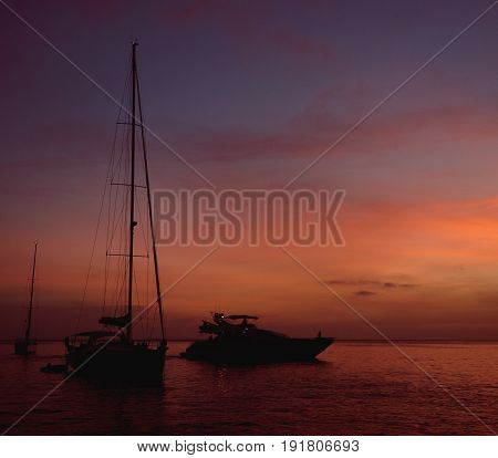 Vessels at Cala Saona bay in Formentera during sunset. Balearic Islands. Spain