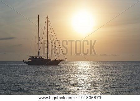 Yacht at Cala Saona in Formentera during sunset. Balearic Islands. Spain