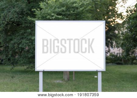 Blank Ad Space Sign Infront Of Trees