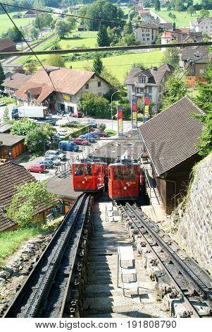 Mount Pilatus Switzerland - 23 August 2006: Pilatus train the world's steepest cogwheel railway nears the top of Mount Pilatus