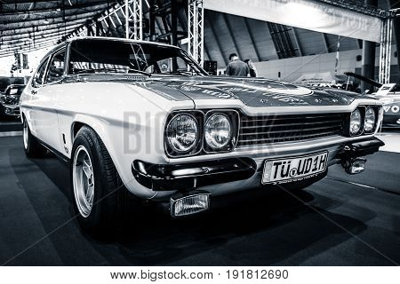 STUTTGART GERMANY - MARCH 03 2017: Mid-size sports car Ford Capri RS2600 1974. Black and white. Stylization. Europe's greatest classic car exhibition