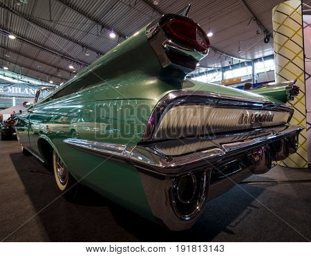 STUTTGART GERMANY - MARCH 03 2017: Rear view of a full-size car Oldsmobile Super 88 Convertible 1959. Europe's greatest classic car exhibition