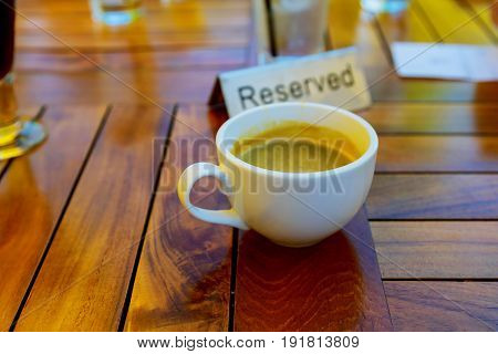 cup of coffee on table in coffee shop cafe cup of coffee on a table in a cafe