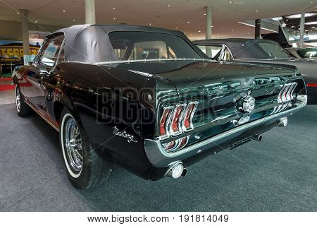 STUTTGART GERMANY - MARCH 03 2017: Pony car Ford Mustang convertible 1967. Rear view. Europe's greatest classic car exhibition