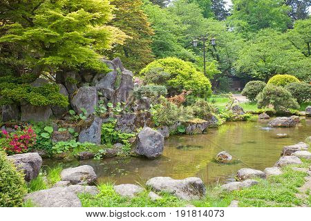 HIROSAKI JAPAN - MAY 23 2017: Traditional Japanese garden on the grounds of Hirosaki Castle Japan. Castle was erected in 1611 by Tsugaru Nobuhira designated National Historic Site in 1952
