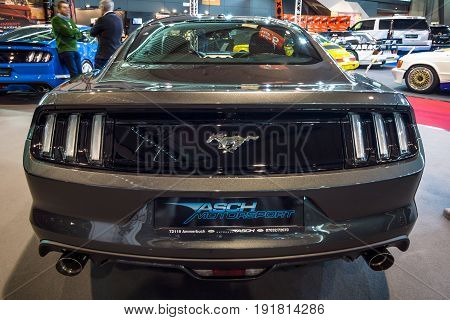 STUTTGART GERMANY - MARCH 03 2017: Pony car Ford Mustang GT V8 Fastback Coupe 2016. Rear view. Europe's greatest classic car exhibition