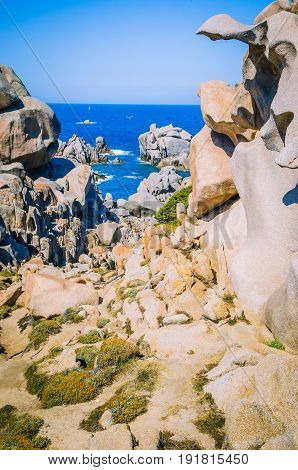 Path betweeen bizarre granite rock formations in Capo Testa, Sardinia, Italy.