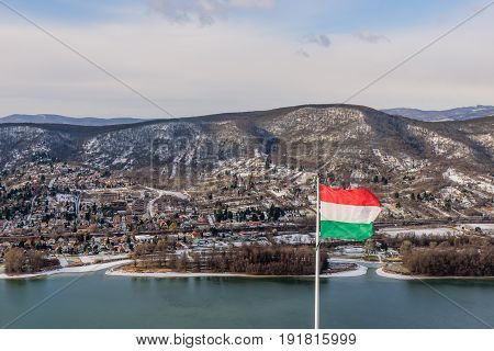 Picturesque winter view of the Danube river and Visegrad with Hungarian flag, Visegrad, Hungary