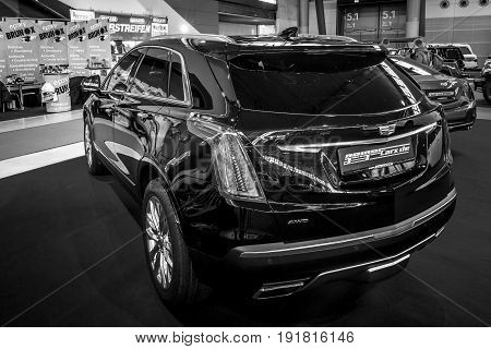 STUTTGART GERMANY - MARCH 03 2017: Mid-size luxury crossover SUV Cadillac XT5 Platinum 2017. Rear view. Black and white. Europe's greatest classic car exhibition