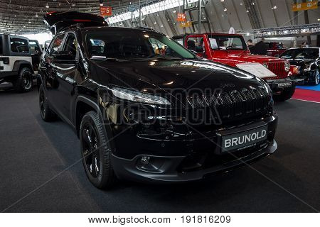 STUTTGART GERMANY - MARCH 03 2017: Mid-size luxury SUV Jeep Grand Cherokee 2017. Europe's greatest classic car exhibition