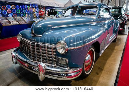 STUTTGART GERMANY - MARCH 03 2017: Full-size car Dodge Deluxe Business Coupe D24 1948. Europe's greatest classic car exhibition