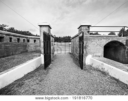 Gates of an old military fort black and white
