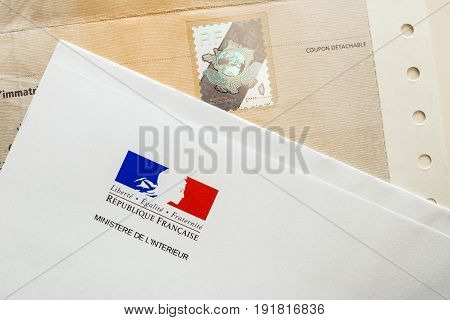 PARIS FRANCE - OCT 26 2016: Special postal envelope of with the logo of The Ministry of the Interior (Ministere de l'Intérieur) next to holographic security stamp