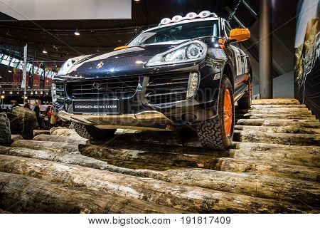 STUTTGART GERMANY - MARCH 03 2017: Mid-size luxury crossover SUV Porsche Cayenne S Transsyberia 2008. Europe's greatest classic car exhibition