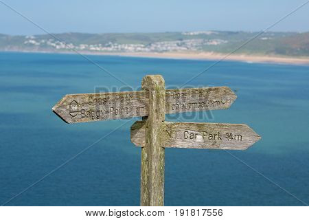Coast path sign to Woolacome Devon England UK in summer with blue sky