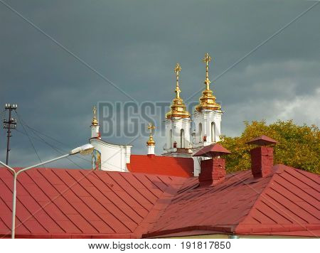 Domes of the Resurrection of the Church and of the roof against the autumn sky, Vitebsk, Belarus - september 2016