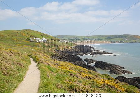 Coast path to Croyde from Woolacome Devon England UK in summer with blue sky