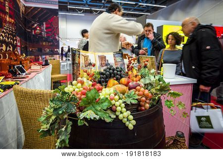 STUTTGART GERMANY - MARCH 03 2017: Italian Pavilion. Sale of traditional Italian goods - wine cheese ham. Europe's greatest classic car exhibition