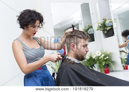 The young man at the hairdresser salon hairstyle make model