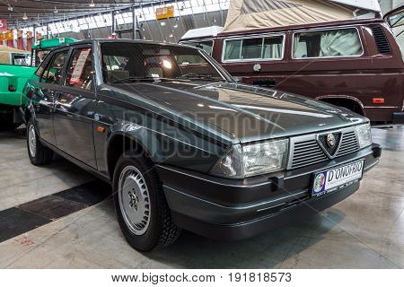 STUTTGART GERMANY - MARCH 03 2017: Compact executive car Alfa Romeo 75 (Tipo 161) 1986. Europe's greatest classic car exhibition