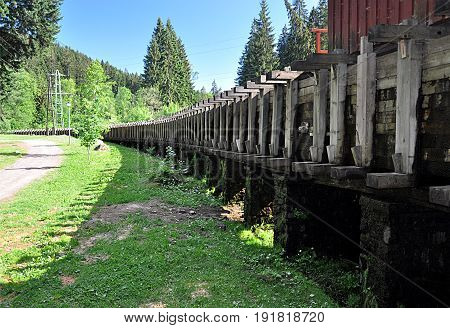 Old wooden water supply in the Sumava country