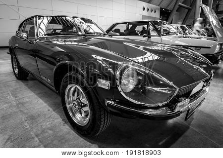 STUTTGART GERMANY - MARCH 03 2017: Sports car Datsun 260Z (Nissan S30) 1976. Black and white. Europe's greatest classic car exhibition