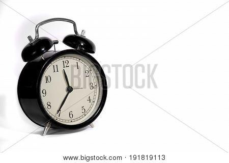 Black vintage alarm clock with qwhite background