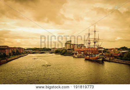 Classic Boat on river Tees at sunset In Stockton-on-Tees UK.