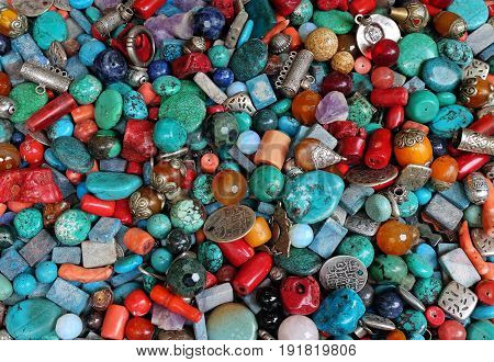 Placer beads of semi-precious stones coins and pendants