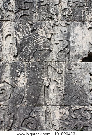 Bas-relief carving of american indian warrior, pre-Columbian Maya civilization, Chichen Itza, Yucatan, Mexico. UNESCO world heritage site