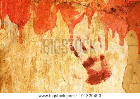 Halloween background. Blood and human palm print on stucco wall. Copy space for your text