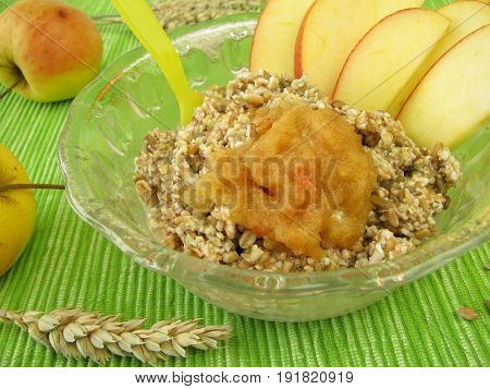 Fresh grain muesli with apples and fresh fruits