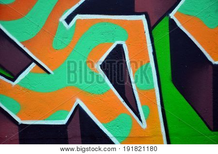 Beautiful Street Art Graffiti. Abstract Color Creative Drawing Fashion Colors On The Walls Of The Ci