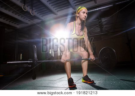 A Beautiful Young Girl In The Gym Trains The Muscles Of The Legs And Back, Deaet Exercises Deadlift,